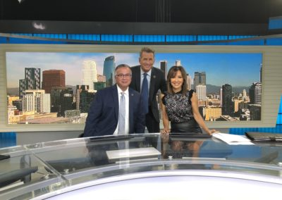 Moses Castillo in a photo with channel 7 anchors